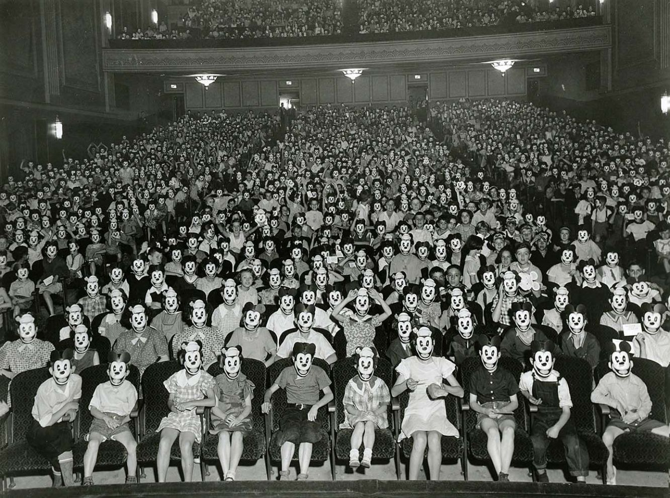 horror cinema with mickey mouse mask viewers