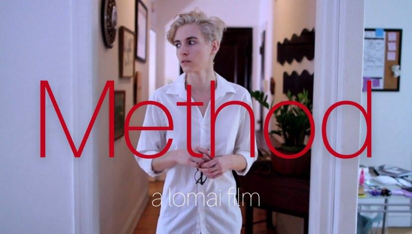 An image of a woman with short bleach blonde hair stood in a white shirt looking nervously to the side. She is in an apartment. Red writing on top of image saying 'Method a lomai film'