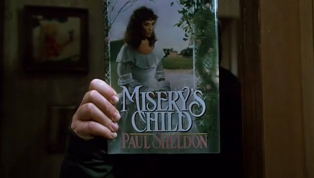 Misery 1990 - 20 years anniversary holding up book in film