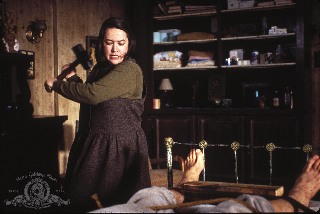 Annie Wilkes smashing Paul's ankles in horror film Misery 1990