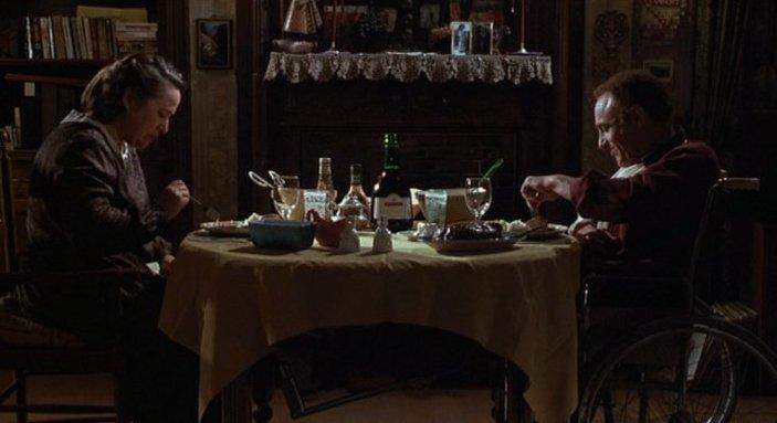 Annie and Paul having dinner in Misery 1990